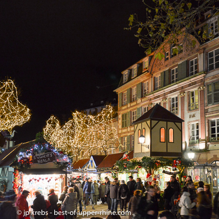 Christmas market atmosphere in Colmar. Colmar is within an easy reach by bus from Riquewihr. No need to take your car and bother for parking!